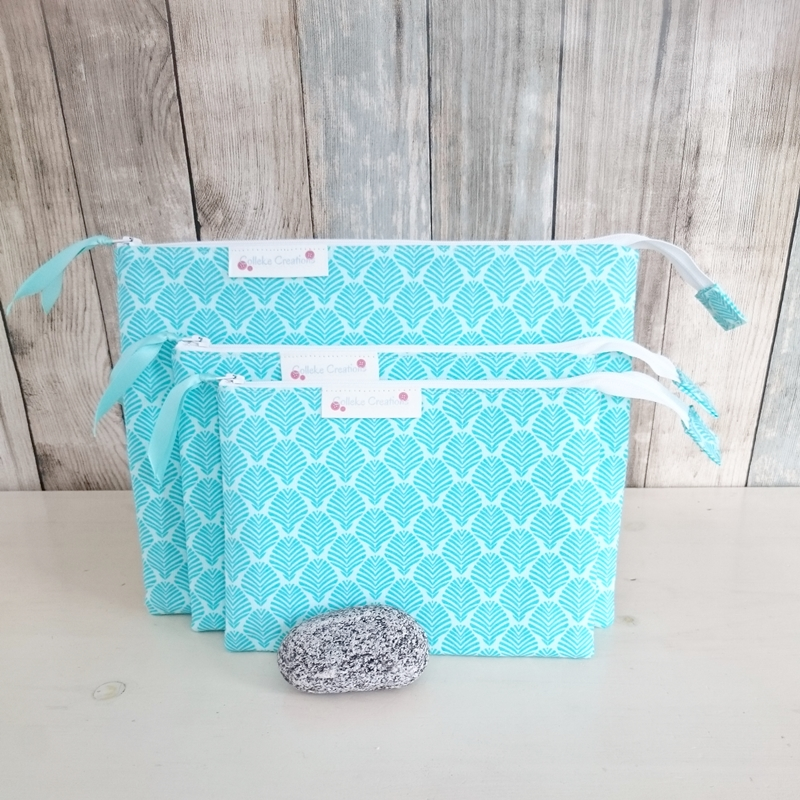 Flat zipper pouches in turquoise