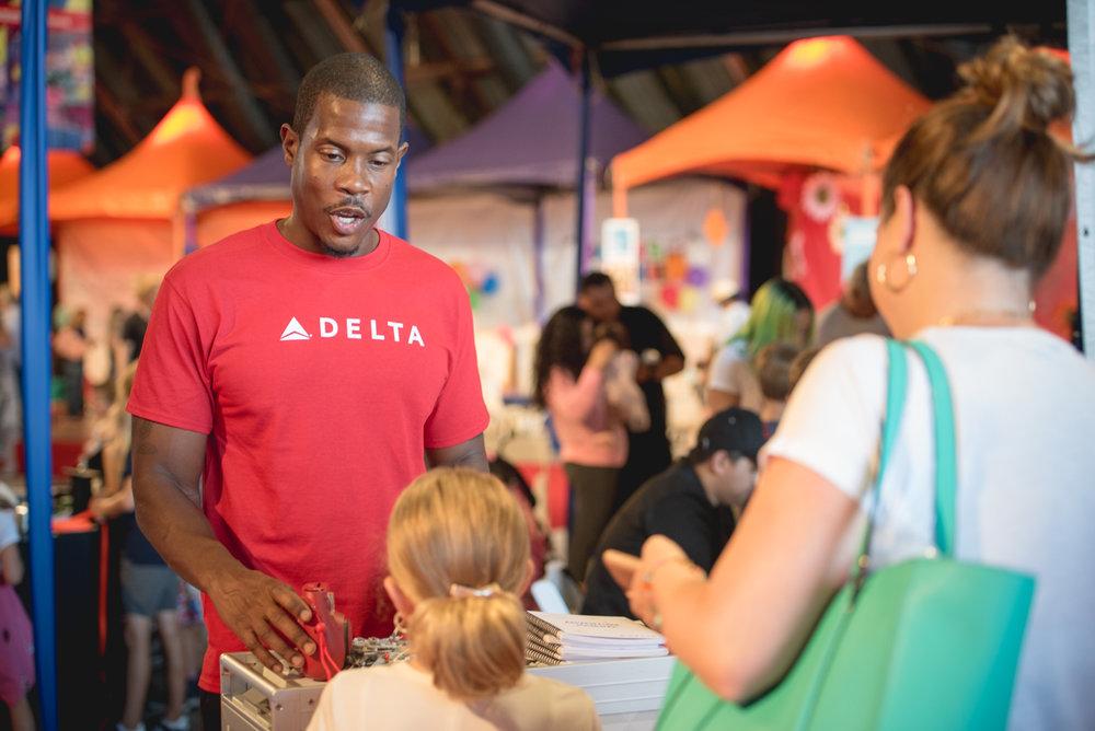 Delta brand ambassador engaging guests at Express Yourself 2017.