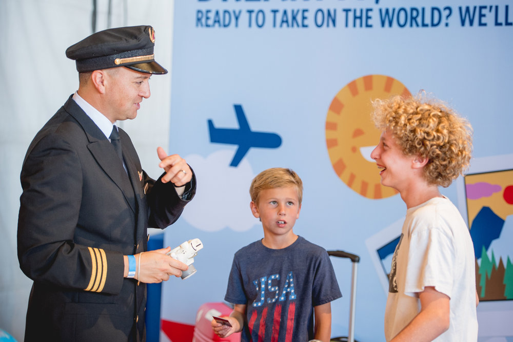 Kids chatting with a Delta Air Lines pilot at the event!