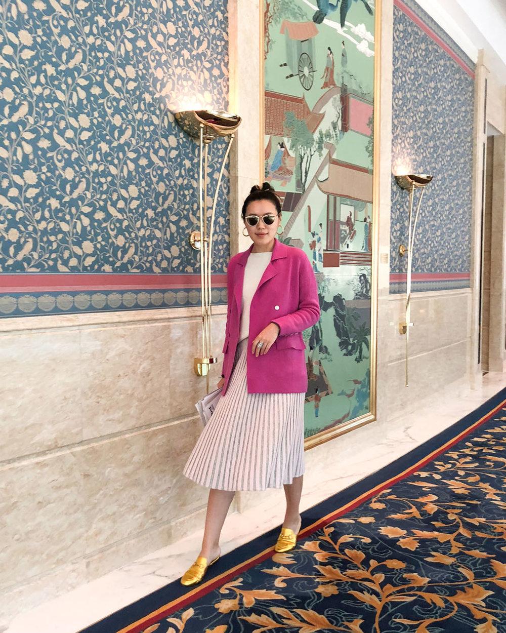 Designer Mandkhai wearing Mandkhai suit blazer and skirt