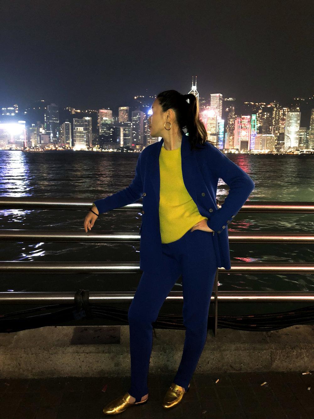 Mandkhai wears blue stirrup trousers and blue suit blazer