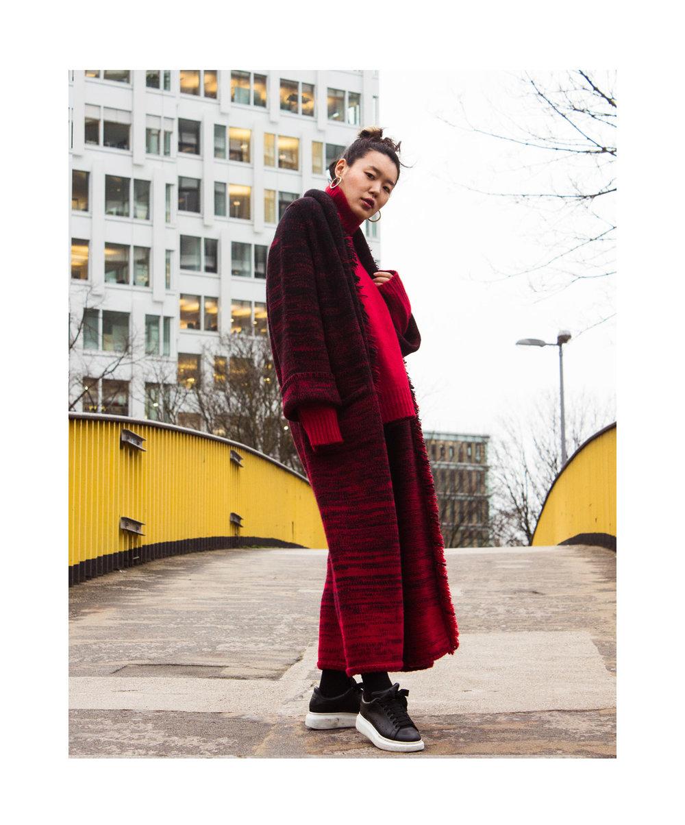 Mandkhai_wearing pimp coat and oversized jumper