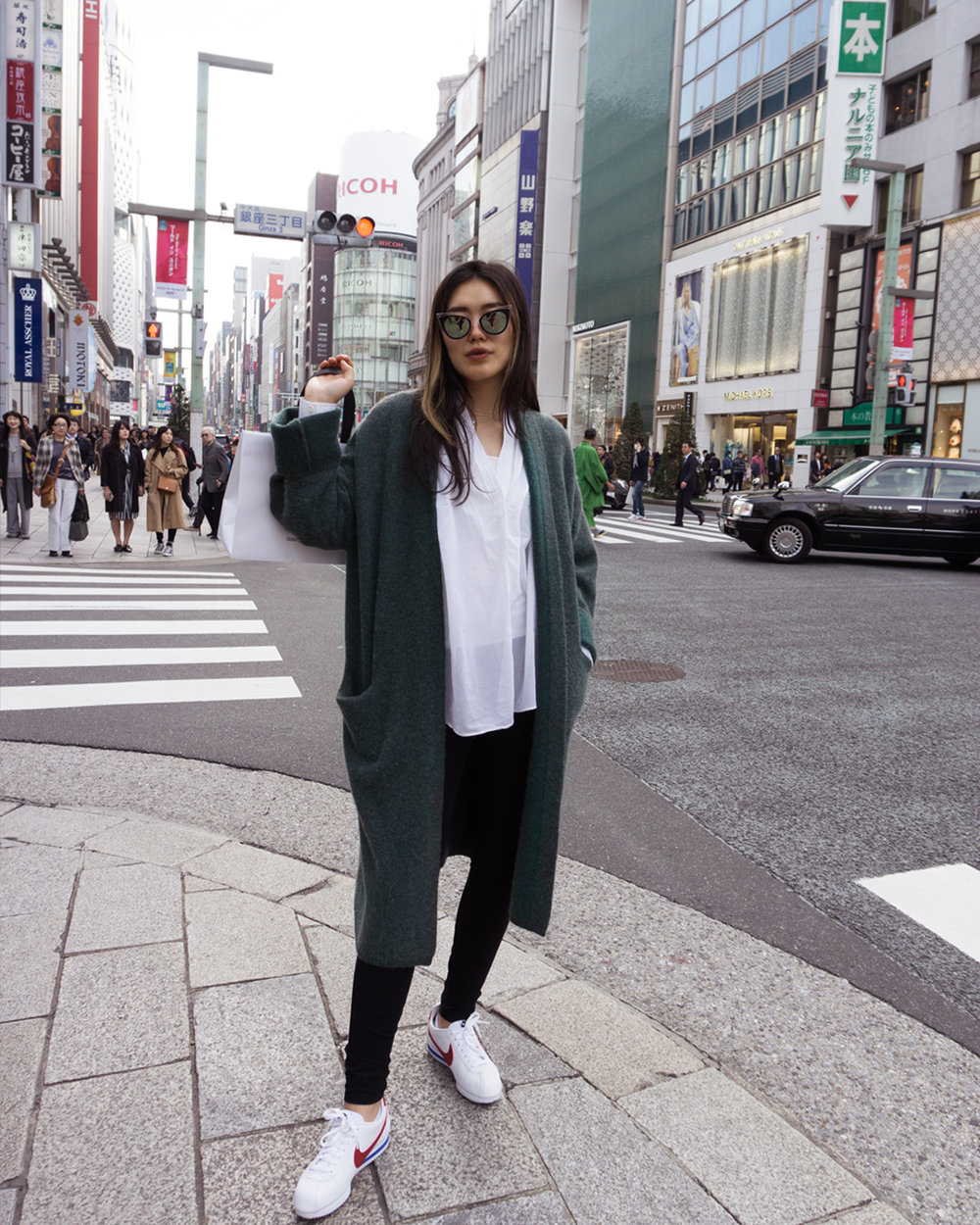 Mandkhai wears - Cloud Coat in green  MANDKHAI  - shop it  here  , Shirt -  UNIQLO , Pants -  HELMUT LANG , Shoes -  NIKE