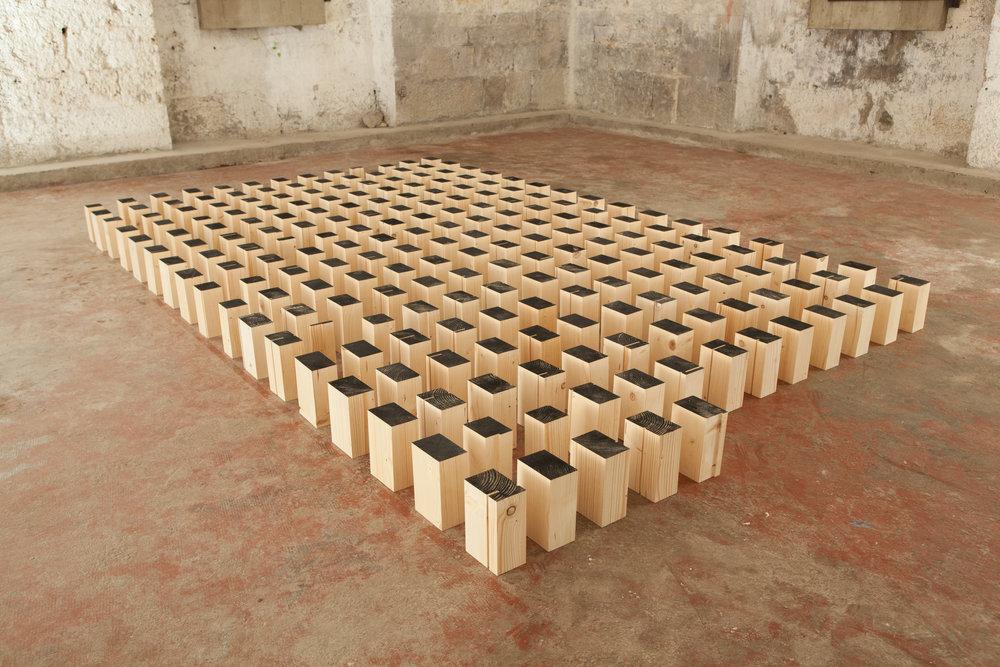 Blocs, 2015 wood, black ink. 213 elements 18,5 x 12 x 8 cm - 7 1/4 x 4 3/4 x 3 1/8 inches (each)