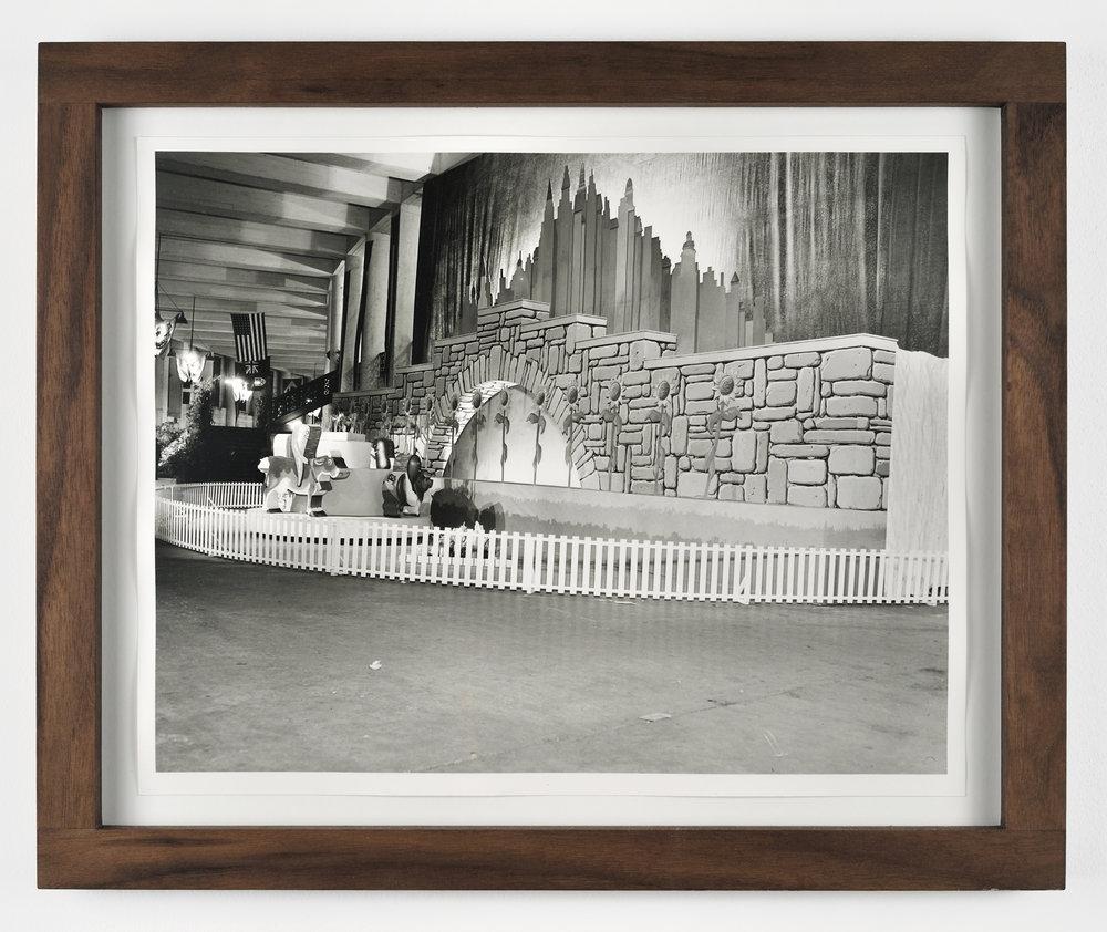 Victory Garden Festival Entrance, 1943-2011 black & white photo, walnut wood frame 35,6 x 43,2 cm - 14 x 17 inches