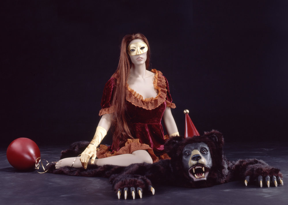 Spirit Girl on A Bearskin Rug (with Balloon), 2008 mannequin, wig, mask, dress, gloves, imitation fur, plaster, foam, magiscupt and paint 89 x 86,5 x 58,5 cm - 35 1/32 x 34 1/32 x 23 inches
