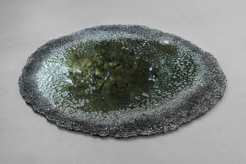 Marlie Mul Puddle (Black, Gum), 2013 sand, stones, resin Ø 33 15/32in Ø 33 15/32inch (Ø 85cm Ø 85cm)