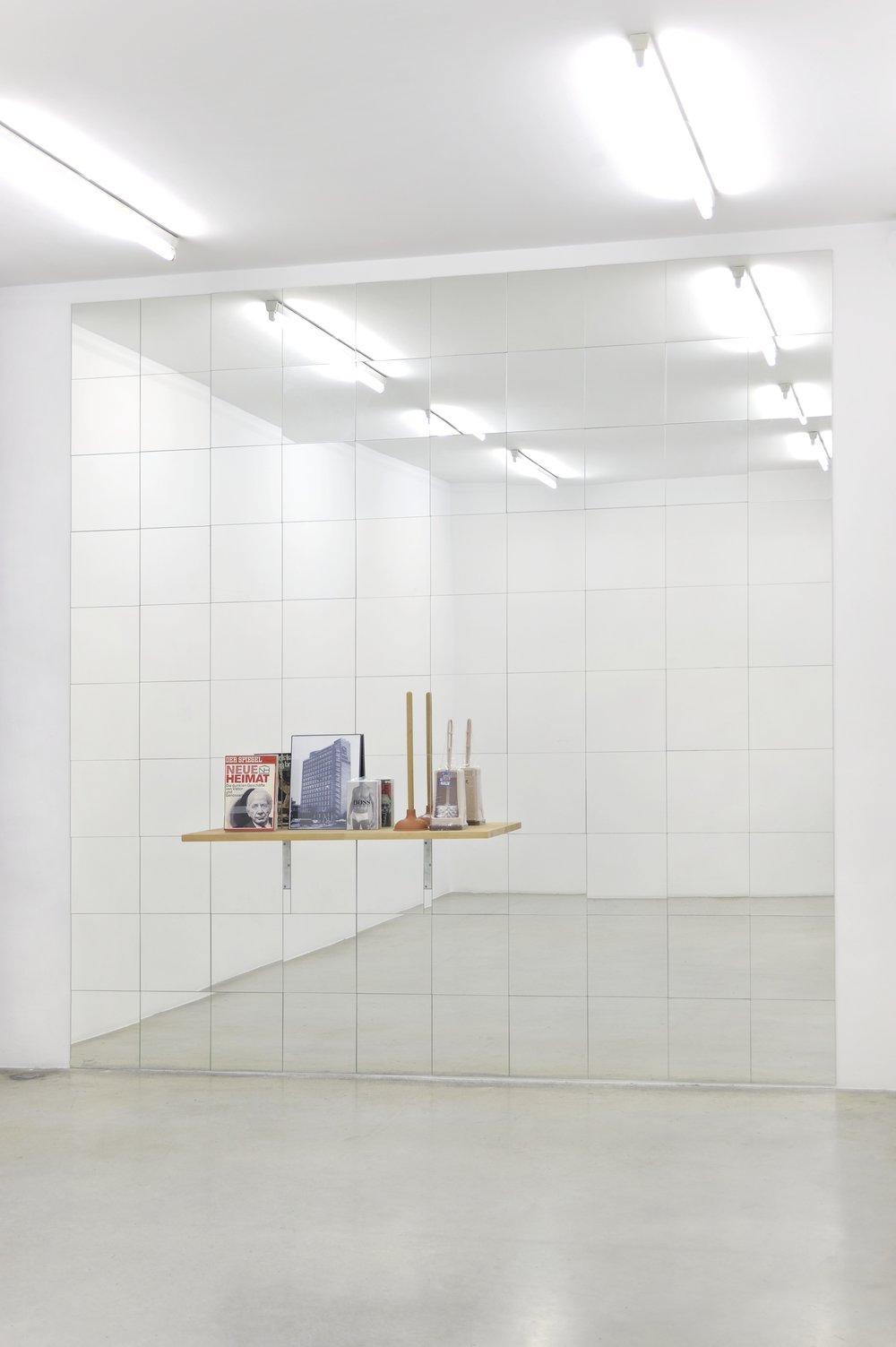 Josephine Meckseper Shelf n°25 (Neue Heimat), 2005 mirrow tile, wood, plexiglas, paper, toilet brush, toilet plunger, fabric 118 1/8 x 118 1/8 x 11 1/32 in (300 x 300 x 28 cm)