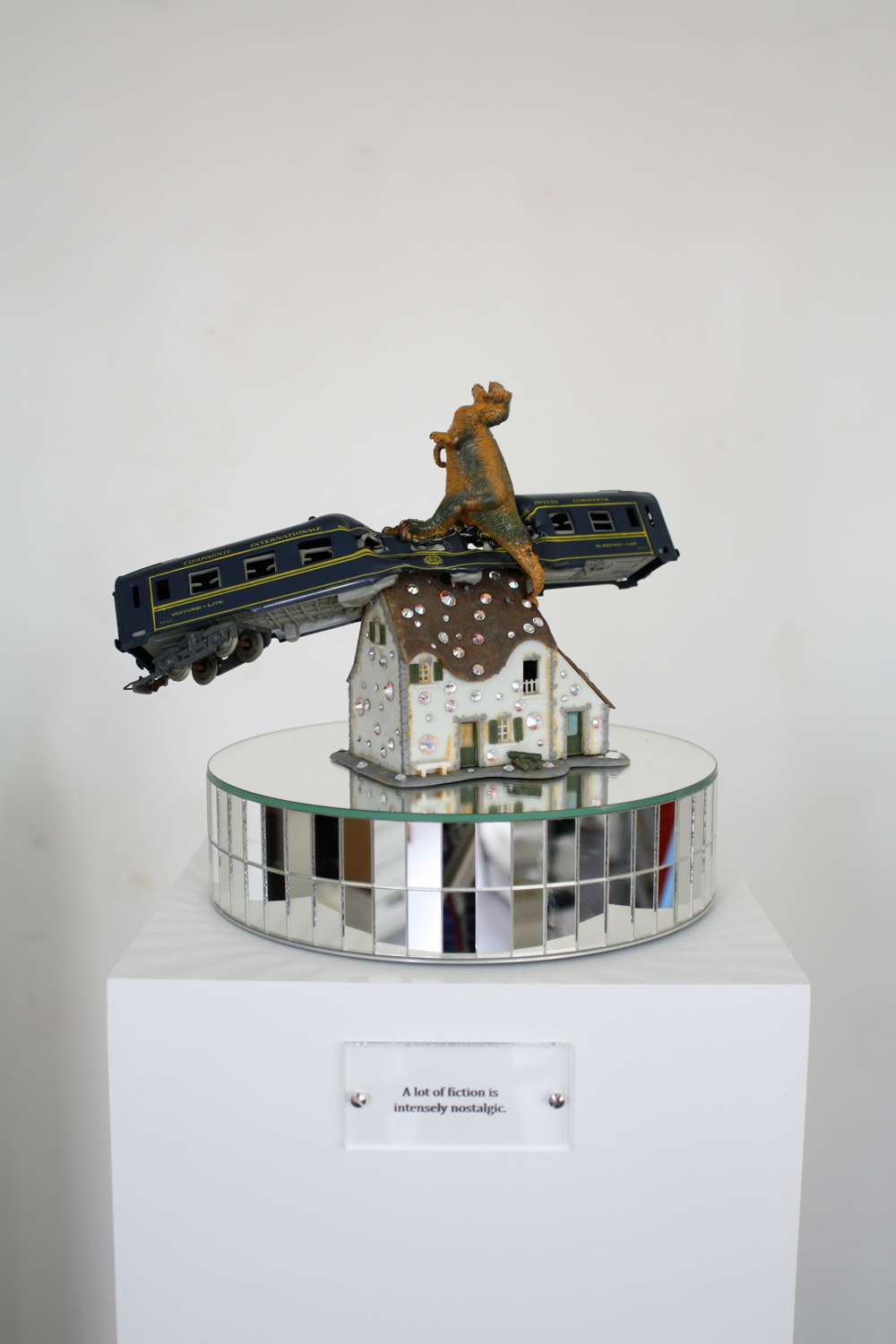 Pierre Ardouvin   A lot of fiction is intensely nostalgic , 2014 Painted pedestal, mirrored rotating stand, engraved plexiglass plate, found objects 53 5/32 x 9 27/32 x 9 27/32 in (135 x 25 x 25 cm) PA14S9