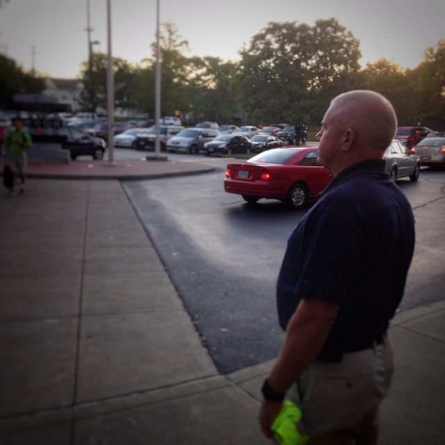 Jerry Beitman greeting students as they enter the doors to Moeller.