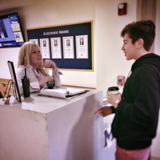 Colleen Lynch conversing with sophomore Matt Farrell
