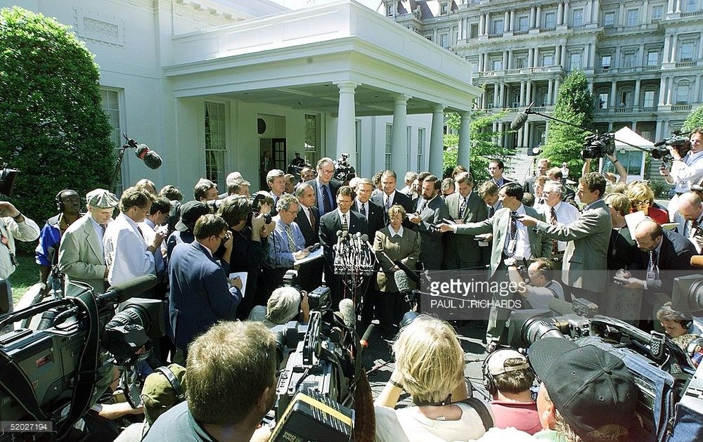 Politician swarmed by press for corrupt actions. Picture from    G etty Images