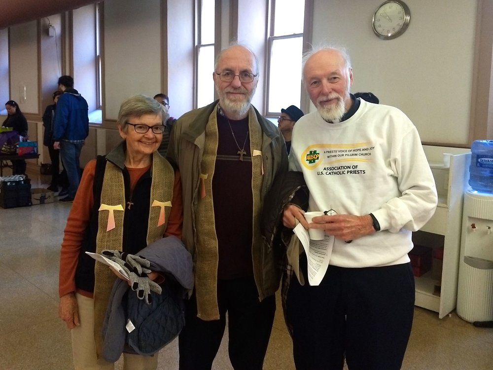 Sister Maria Lucey, associate director of the Franciscan Action Network, Patrick Carolan, FAN executive director, and Father Bernard Survil, pose before departing a staging area for the Catholic Day of Action.