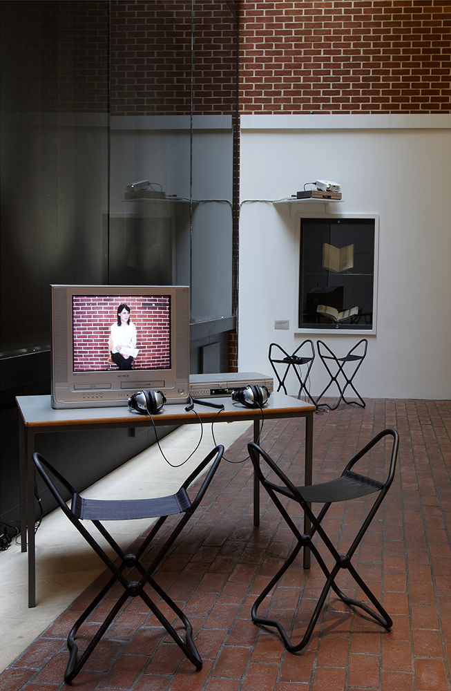 Installation shot of video work 'The Argument of the Broken Window Pane'