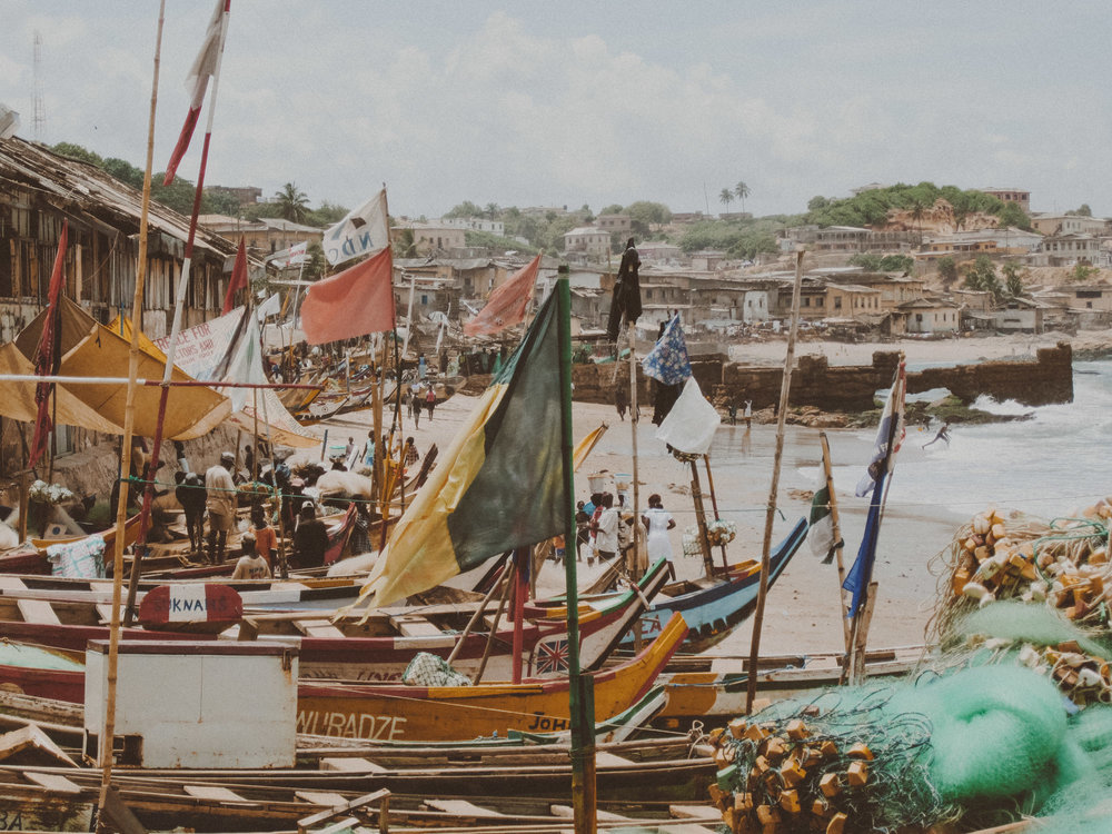 Fishing boats in Cape Coast, Ghana |  Photo by Caroline Taft, The Brazen Gourmand