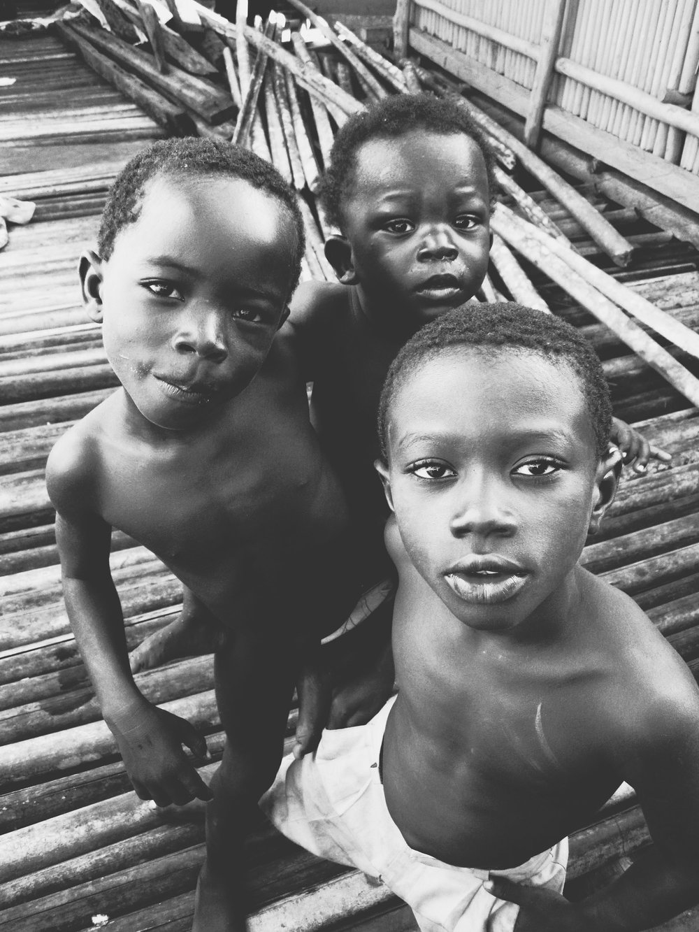 Children from Nzulezo, the village on stilts  |  Photo by Caroline Taft, The Brazen Gourmand