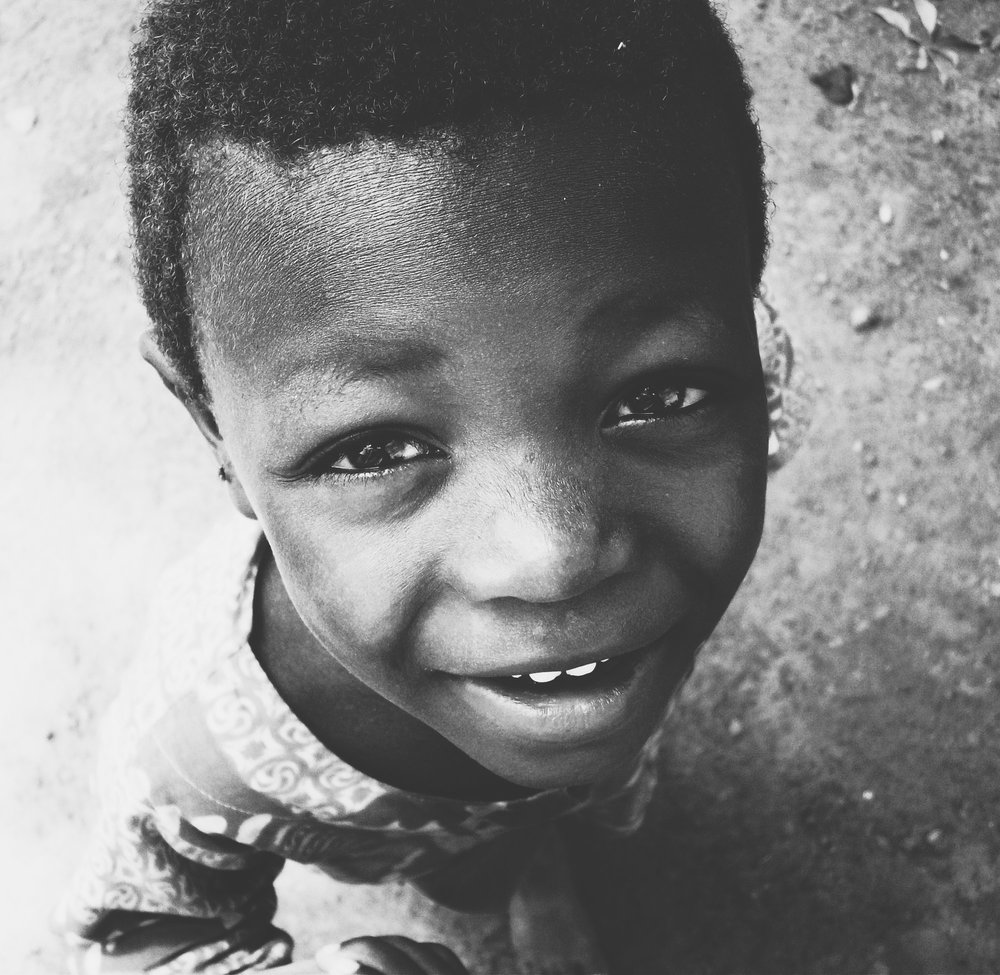 A smiling child in Cape Coast, Ghana  |  Photo by Caroline Taft, The Brazen Gourmand