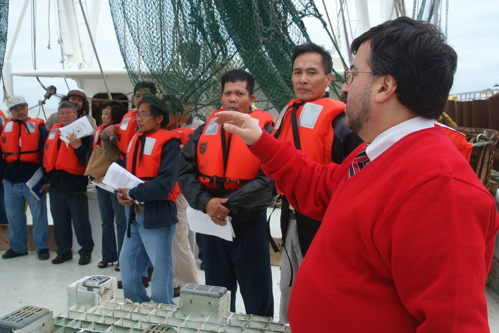 Dr. Jeff Levin (right) conducting a training with Vietnamese-American shrimp fishermen.