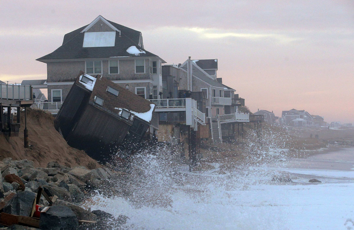 The rising tide comes up against a house on Plum Island that came off its foundation during an overnight winter storm on in Newbury in this file photo