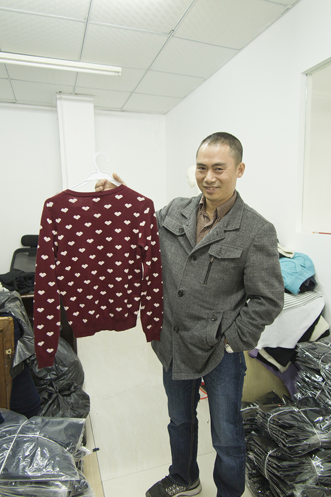 16.01.14-UABB-2015-Mr.Liu-showing-a-fabric-that-he-is-prioud-of-and-that-he-thinks-represents-himself-and-this-factory.jpg