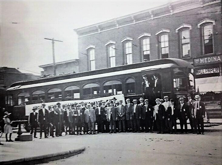 The train car shown here, and many other cars like this one, was able to transport an abundance of people like the group shown in the picture