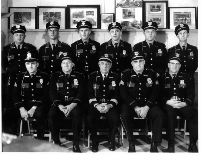 Medina City Police Department, Medina, OH – April 1966    Seated Left to Right: Sgt. Homer C. Davis, Jr., Lt. Clarence Klooz, Chief Homer C. Davis, Sr., Sgt. Sidney Bowman, and Det. Mel Shirey    Standing Left to Right:Richard Leggett, James Auker, John Hoyt, Chester Stuchinski, James Dunkle, and Arnold Siegfried