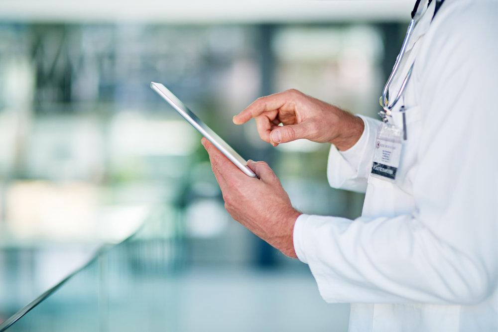 doctor-technology-tablet-587522724.jpg