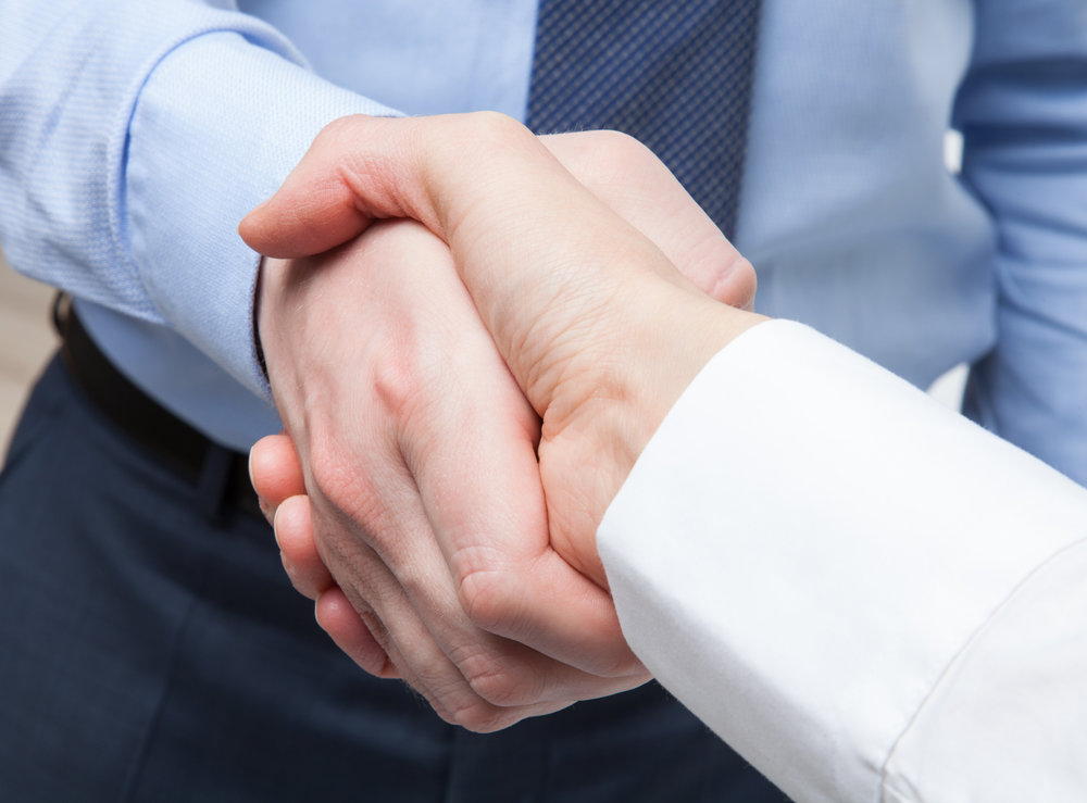 Business-handshake-481806018_5067x3744.jpeg