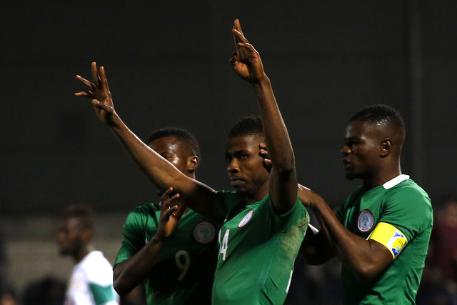 Kelechi Iheanacho (20) celebrates after equalising from the spot — his fifth goal in six games for the Super Eagles.