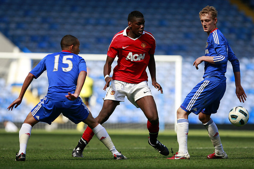 Pogba (C) during his first stint as a Manchester United player