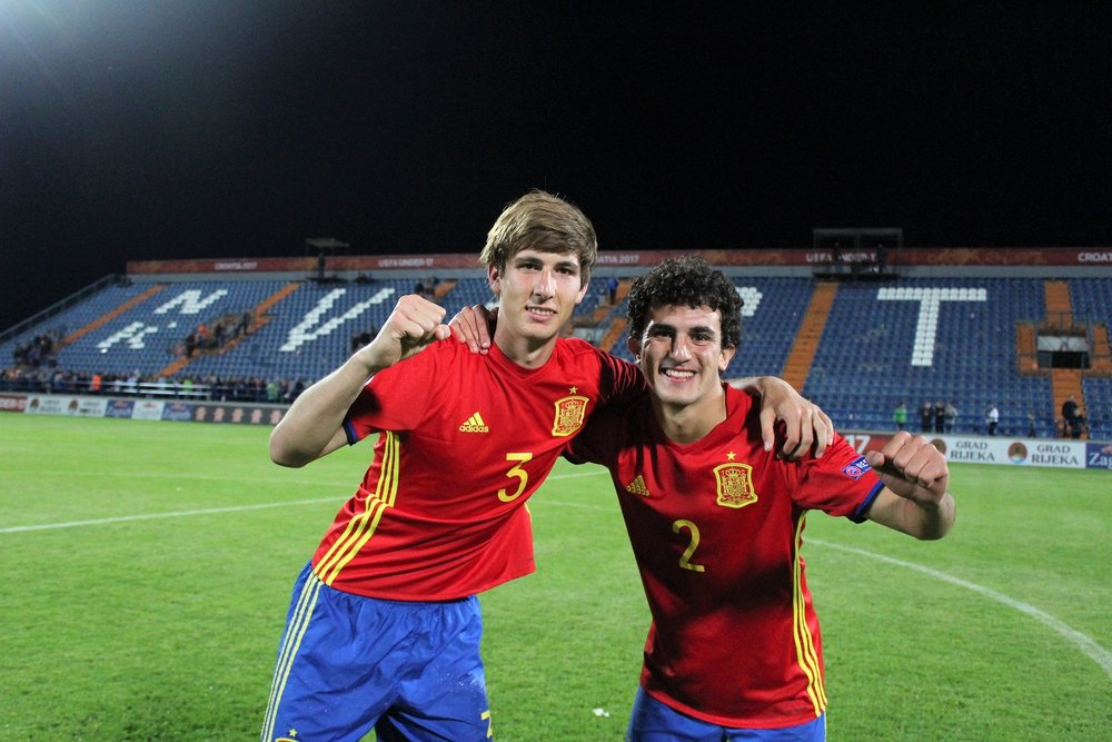Juan Miranda (left) celebrates with full-back partner in crime Mateu Morey.