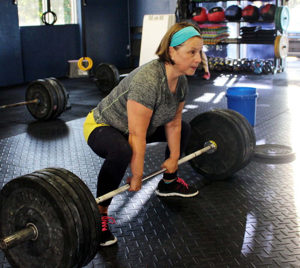 Ana setting up for a Sumo Deadlift