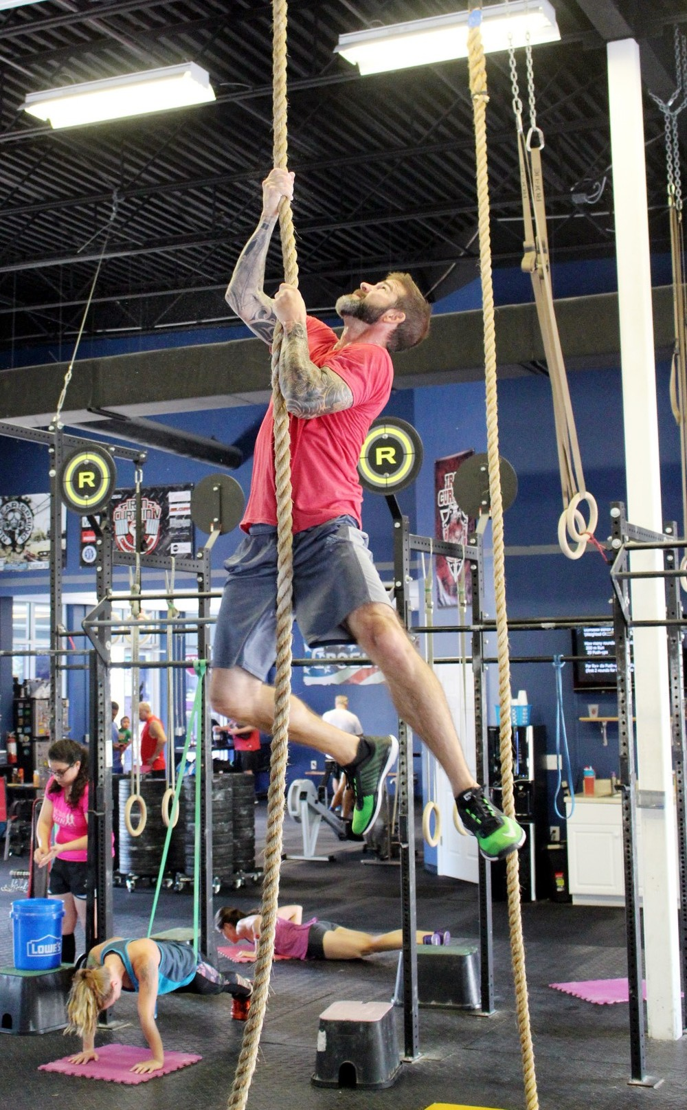 Heath doing a legless rope climb