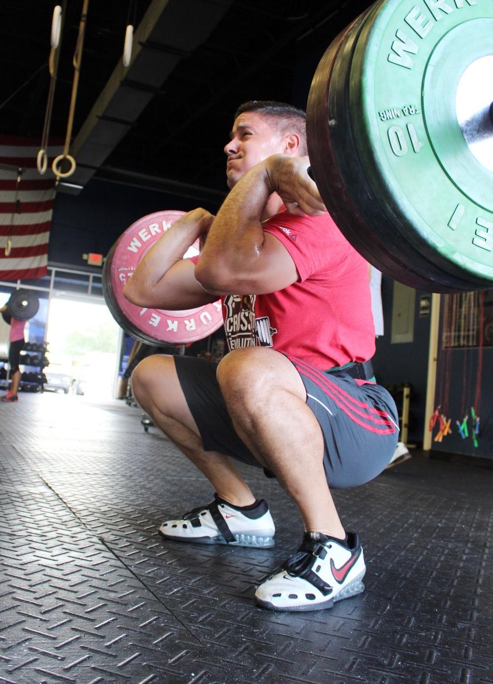 Alec front squatting.