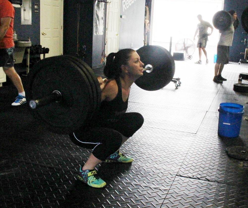 Melissa W at the bottom of a Back Squat