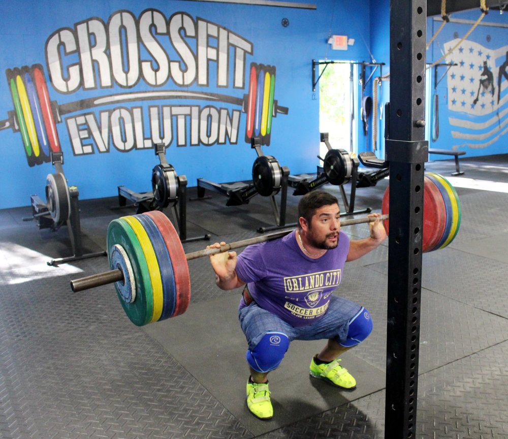 Nestor matching up his Back Squat (at 374 in the pic, 407 afterwards) with the logo.
