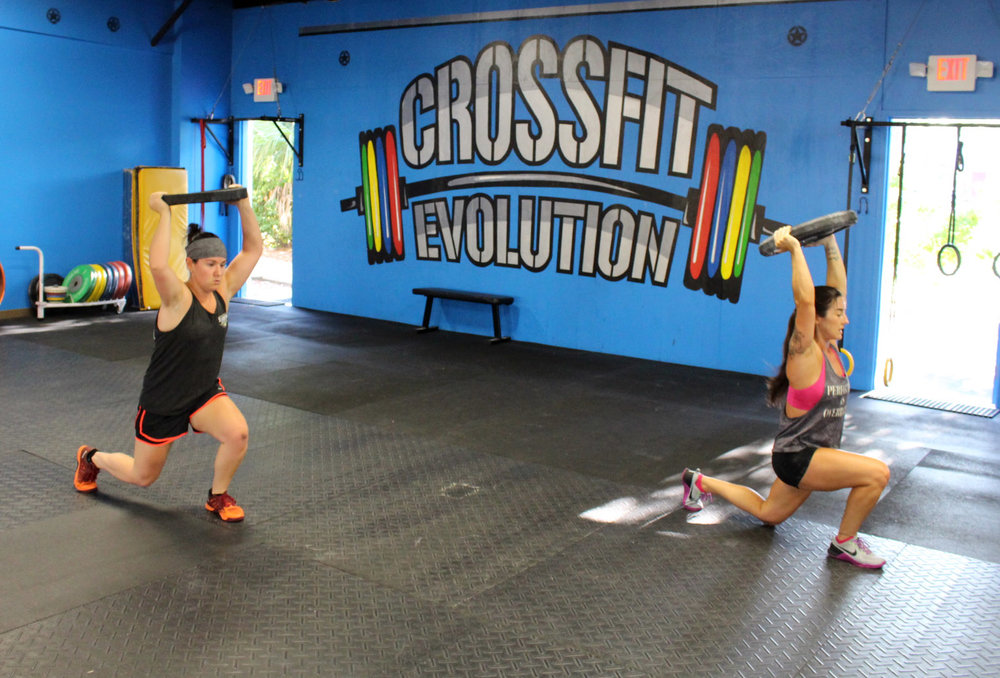 Kayla and Alexa doing Overhead Lunges