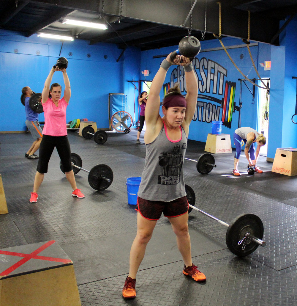 Kayla (front) & Beth swinging Kettlebells
