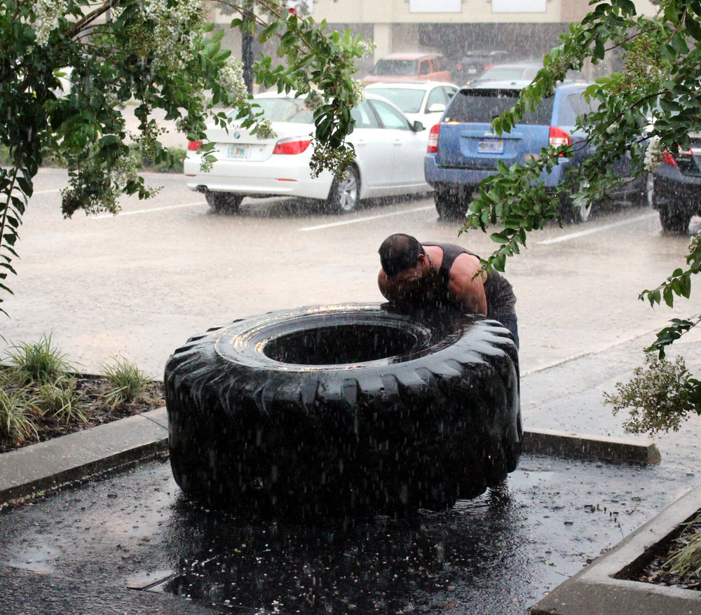 Ismael decided to go and flip tire in the rain to cool off...