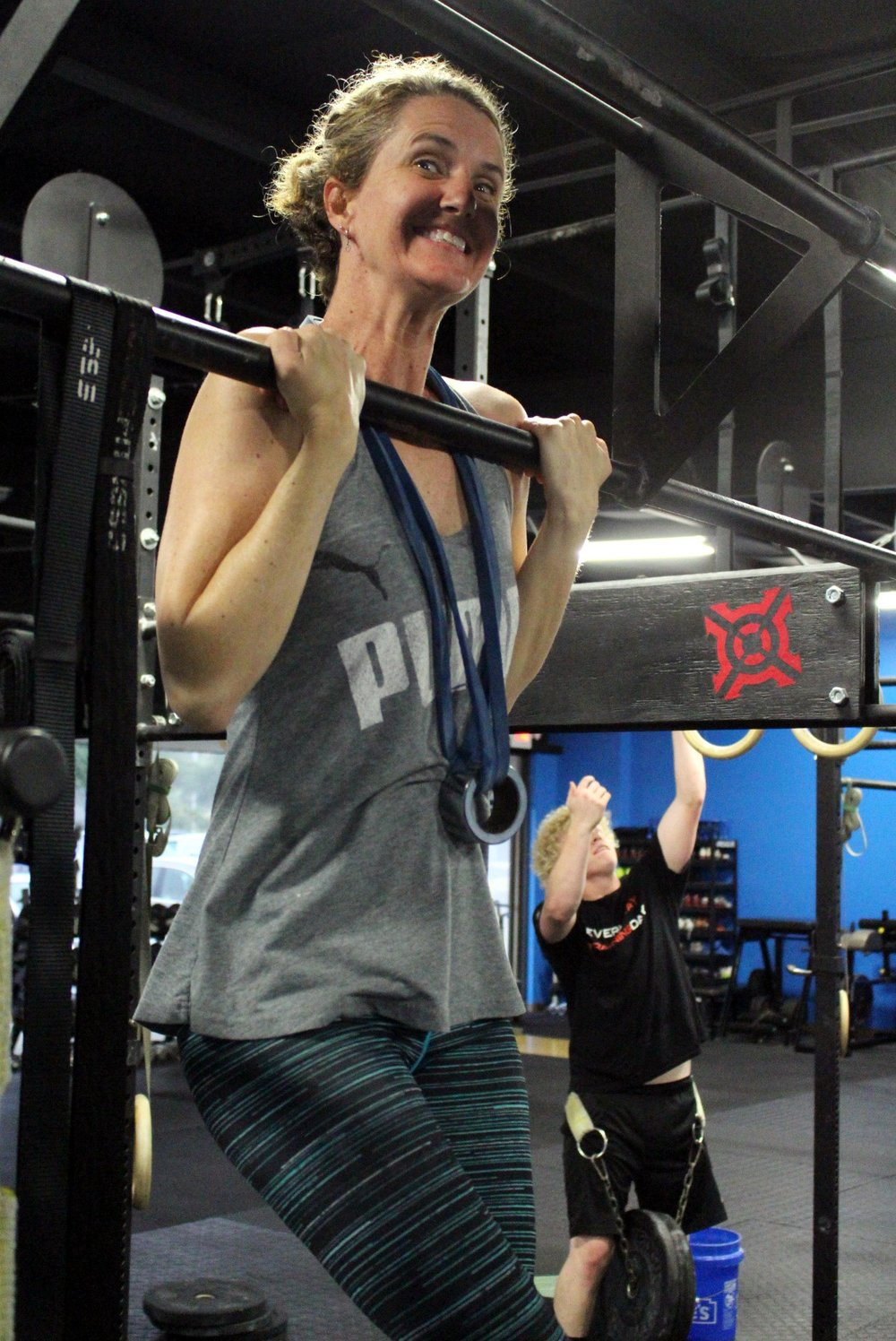 Becky with her first ever Weighted Chest To Bar Pull-up!