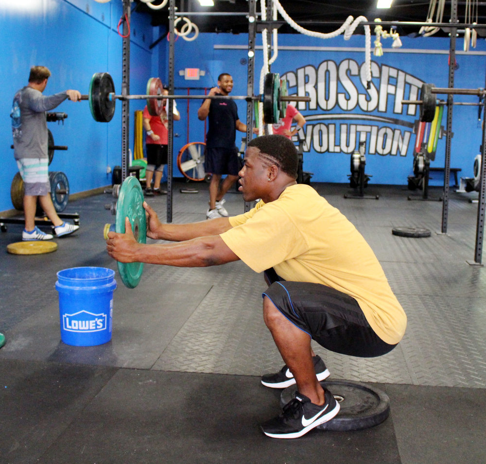 Alphonso working on squat flexibility