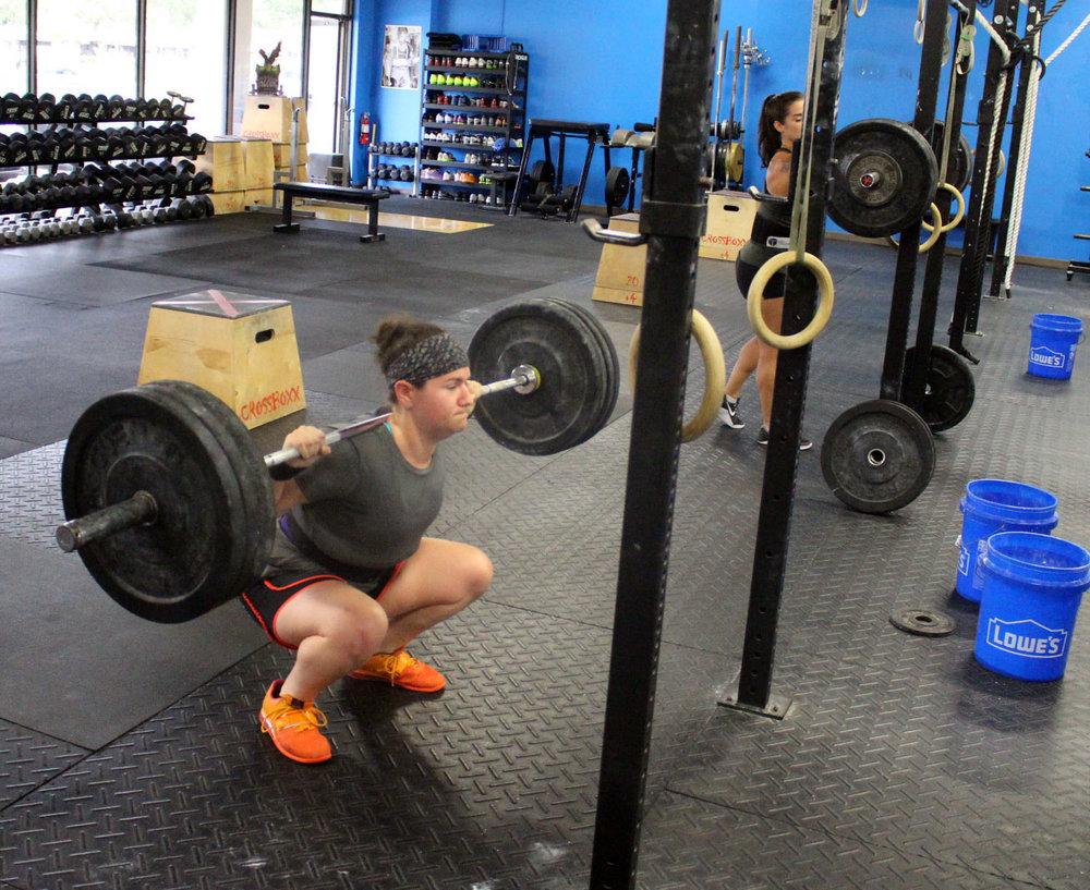 Kayla back squatting