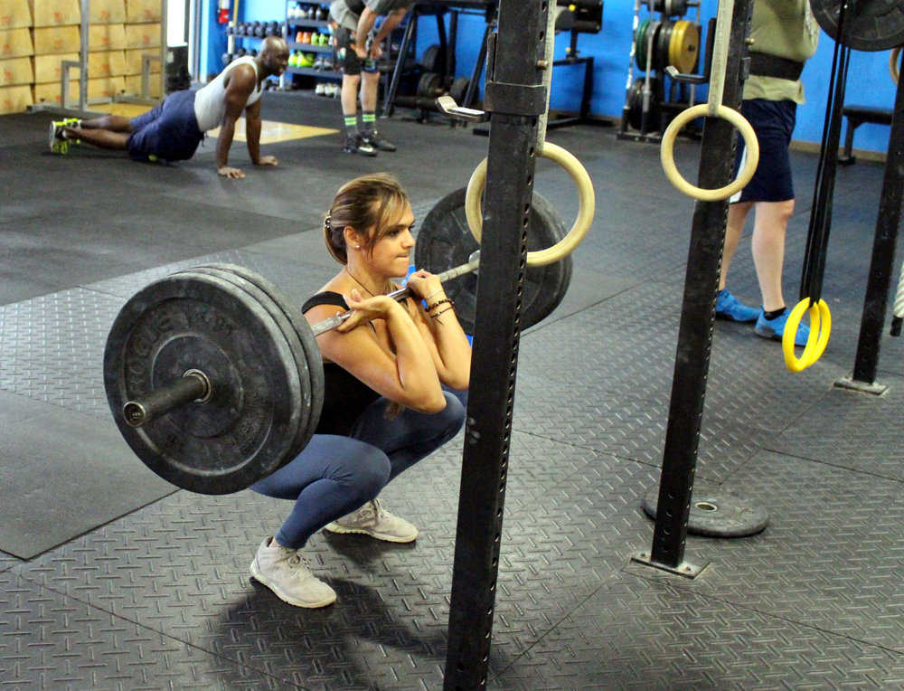 Alix at the bottom of a Front Squat