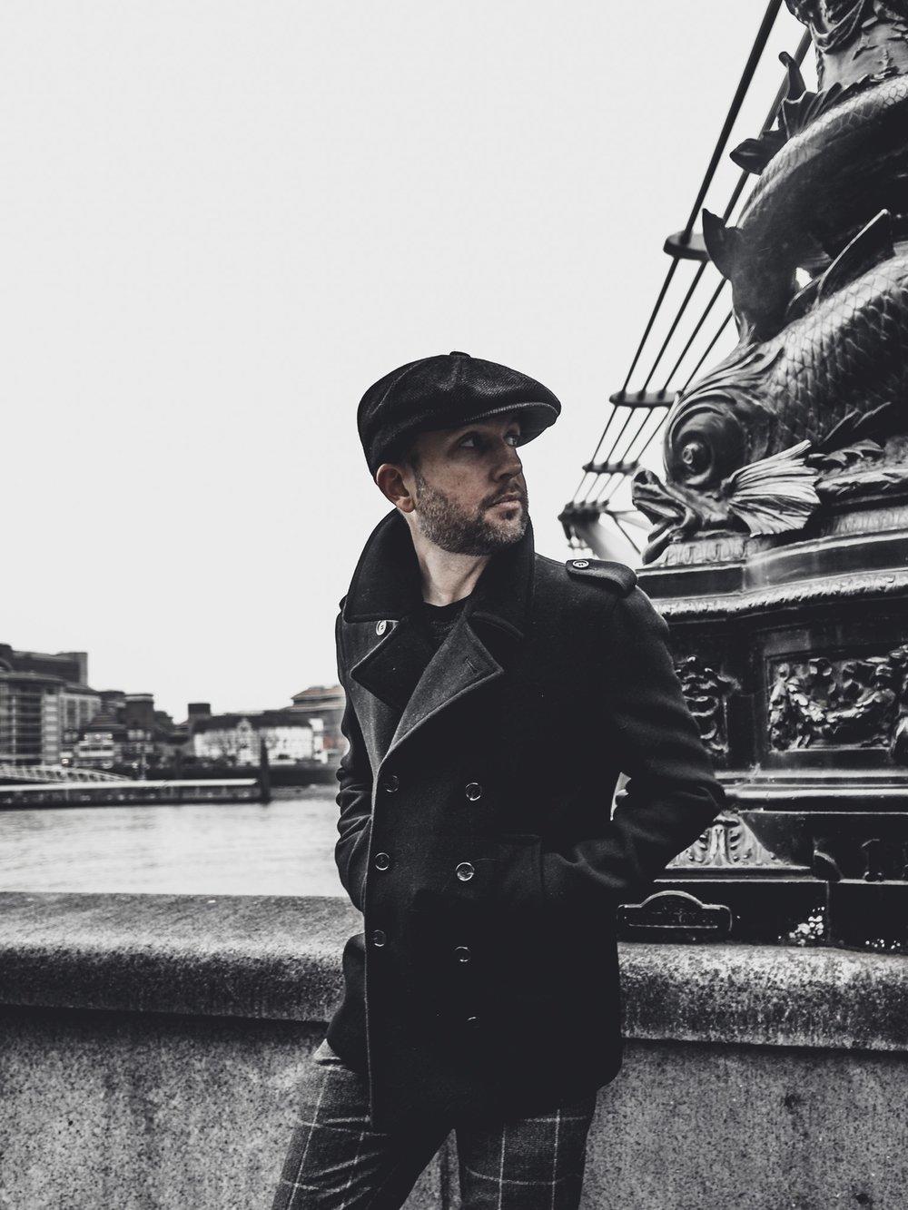 Jay McLaughlin OOTD Outfit Peacoat London Newsboy Cap