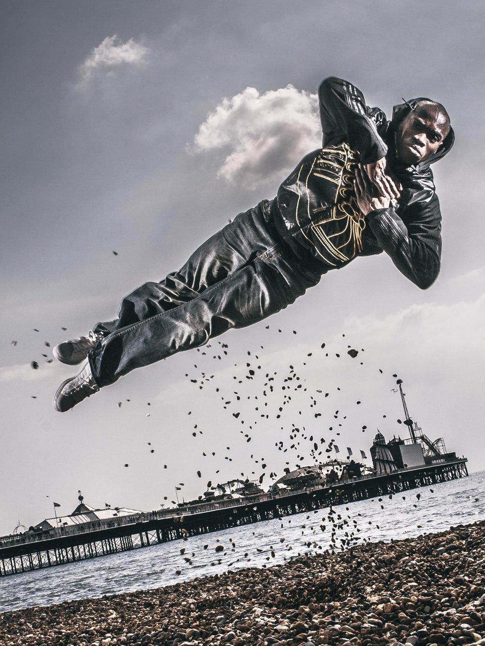 JP Omari Brighton Pier Photography Jumping Breakdancer Breakdance Jump Stones Award Winning Photo