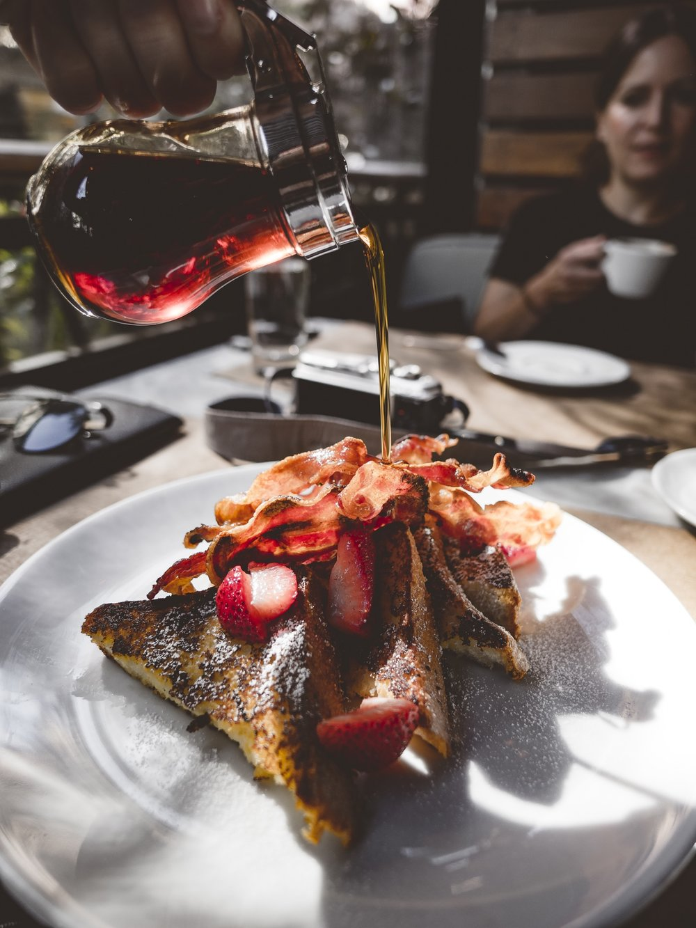 French Toast Bacon Strawberries Maple Syrup New York City NYC Breakfast Pour Pouring