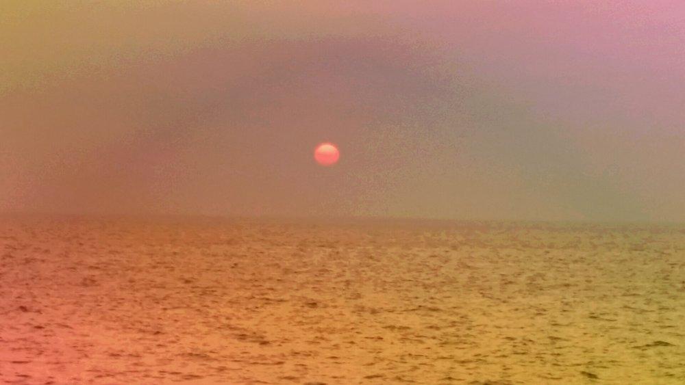 Solnedgang på Marine drive, hvor vi av og til henger.