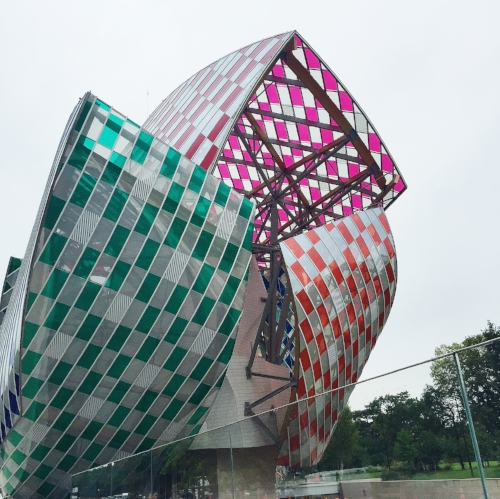 "Daniel Buren designed ""Observatory of Light"" is like glass ""shields"" covering Frank Gehry's structure."