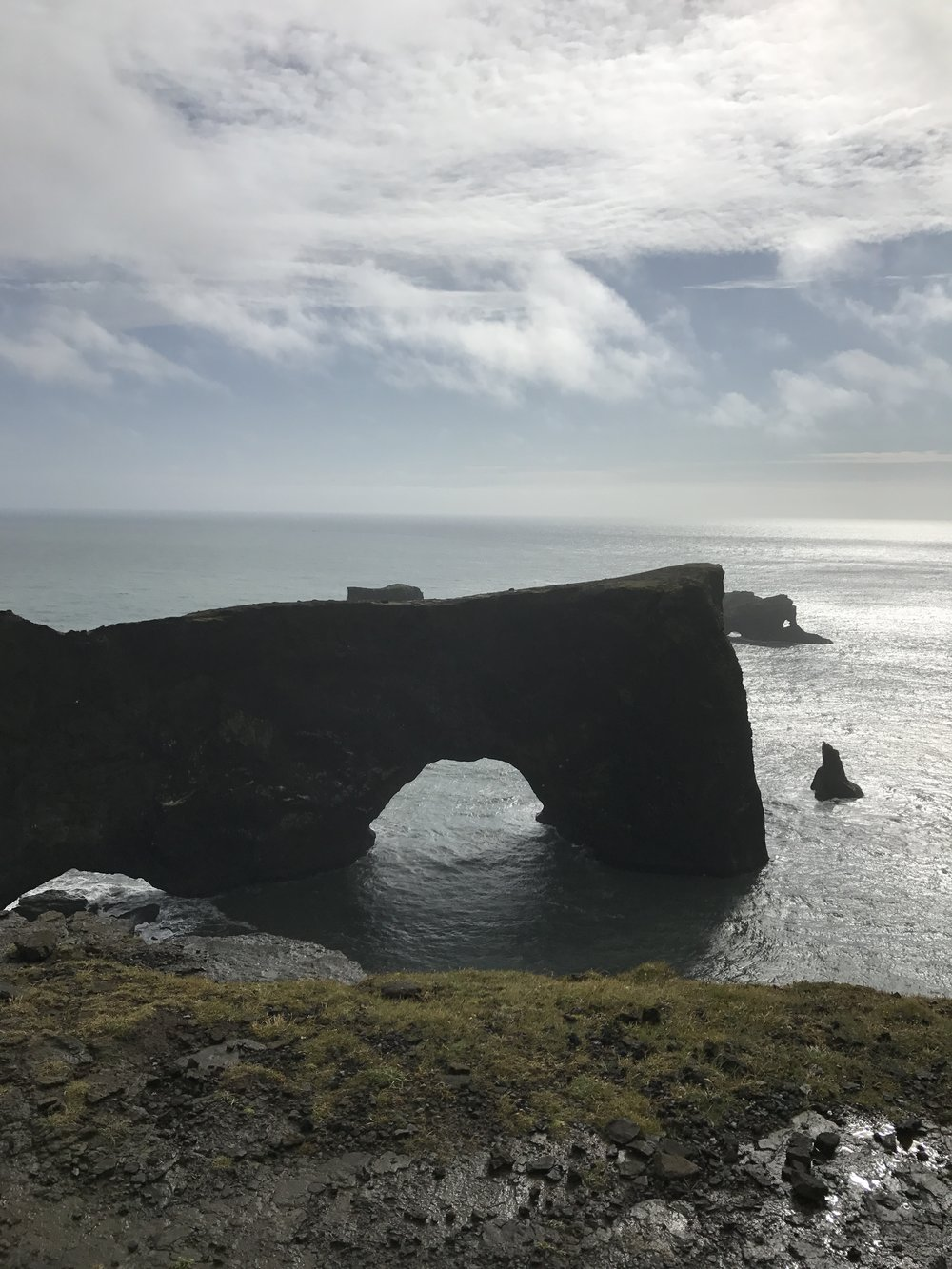 Day 3: View or the arch from Dyrhólaey Lighthouse. The ocean and wind created the hole and it's so big boats and ships can sail through.