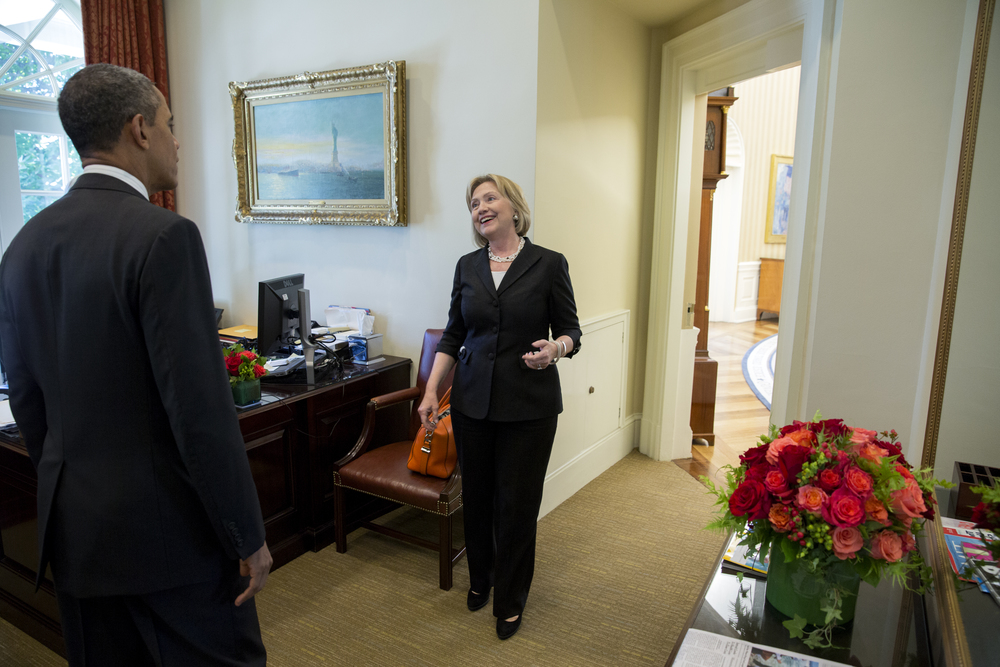 President Obama greets former Secretary of State Hillary Rodham Clinton in the Outer Oval Office. 2013.